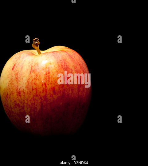 Red apple on black background - Stock Image