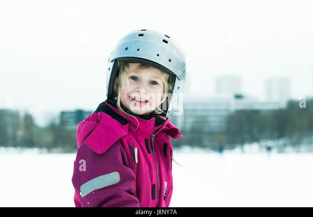 Portrait of smiling girl (4-5) in helmet - Stock-Bilder
