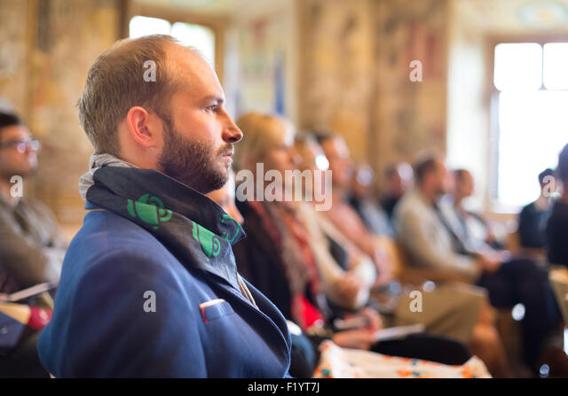 Entrepreneur in audience at business conference. - Stock-Bilder