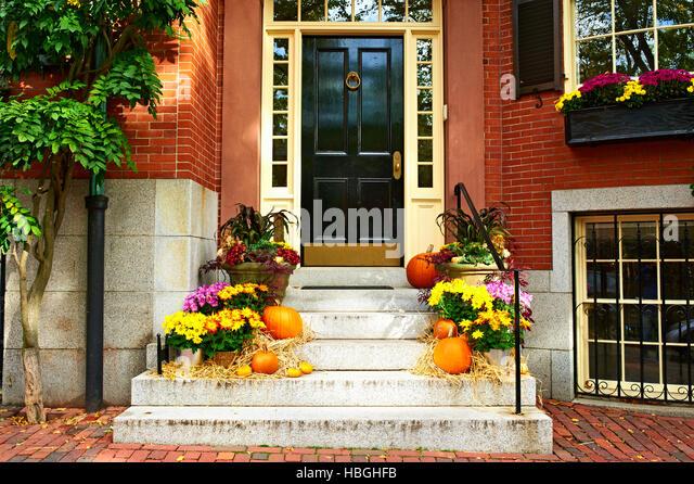 Pumpkins near the door for Halloween - Stock Image