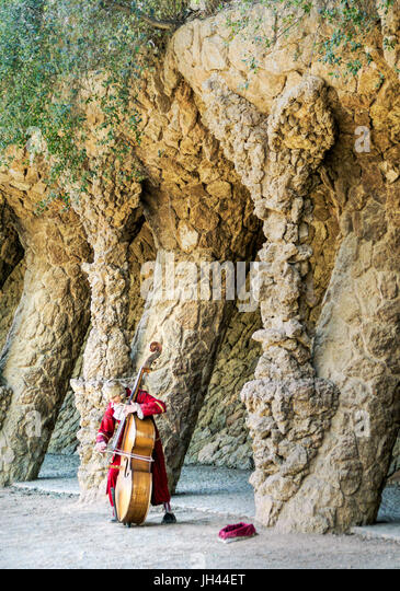 A musician plays for tips in Gaudi's Parc Guell. Barcelona, Spain - Stock Image