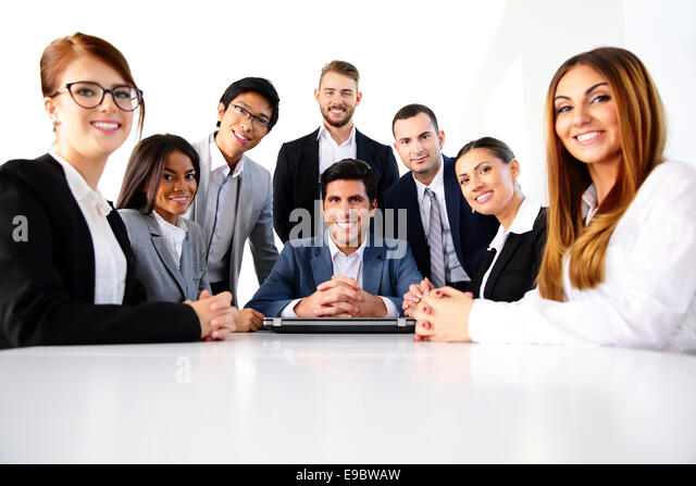 Group of a smiling colleagues in office - Stock Image