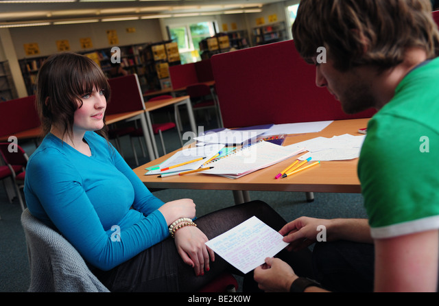 Students revise in library at sixth form further education college - Stock Image