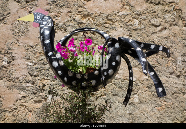 Recycled tires used as flowerpots - Stock Image
