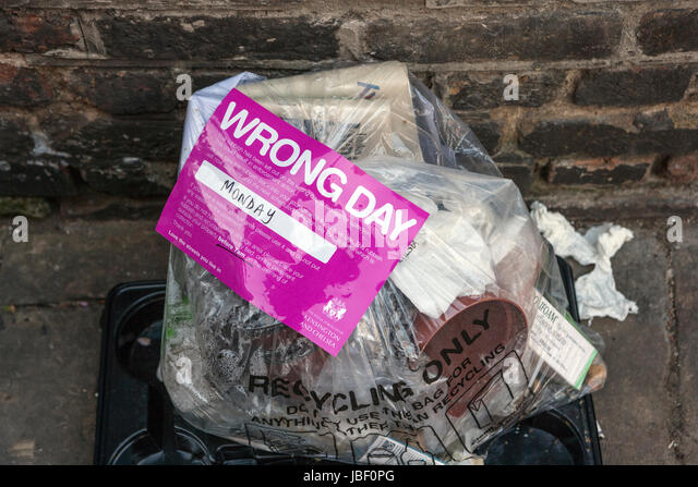 Recycling Rubbish Bag with Wrong Day Warning Sticker, Kensington and Chelsea, London - Stock Image