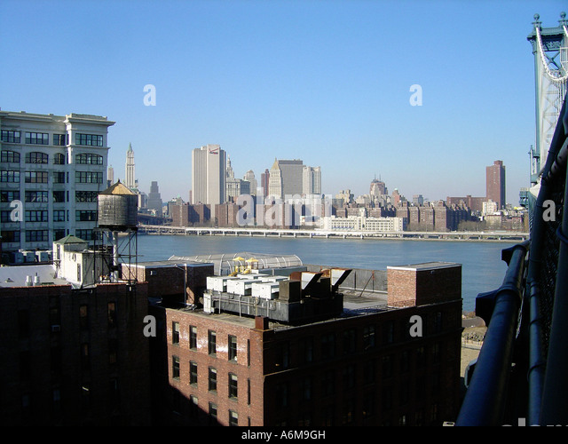 View of Lower Manhattan from Manhattan Bridge New York City NYC - Stock Image