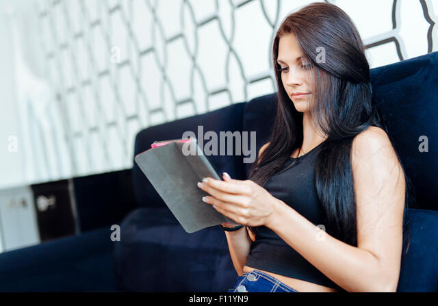 Beautiful happy young woman using a tablet - Stock-Bilder