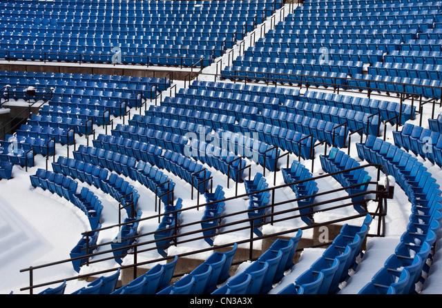 Empty stadium seats in the snow - Stock Image