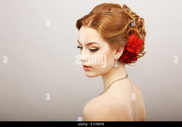 Daydream. Tenderness. Golden Hair Female with Red Flower. Platinum Shine Necklace - Stock Image