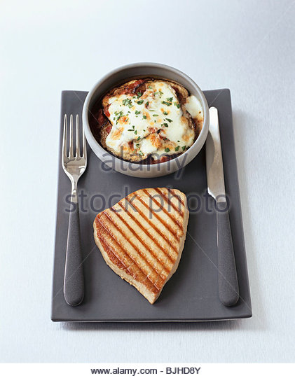 Grilled tuna with baked aubergine - Stock Image