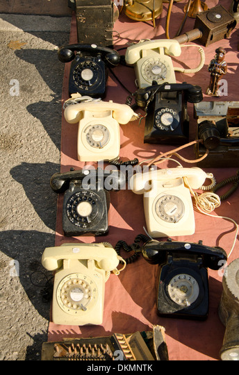 Collection of old  rotary dial telephones for sale on a second hand market in Fuengirola, Spain. - Stock Image