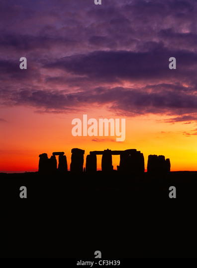The Stonehenge trilithons silhouetted after sunset. - Stock Image