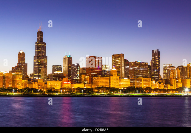 Chicago skyline and Lake Michigan at dusk with the Willis Tower, formerly the Sears Tower, on the left, Chicago, - Stock Image
