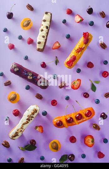 Sweet patterns: eclairs - Stock Image