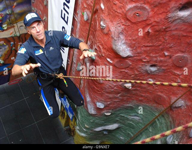 Charity climber trying to overcome vertigo - Stock Image