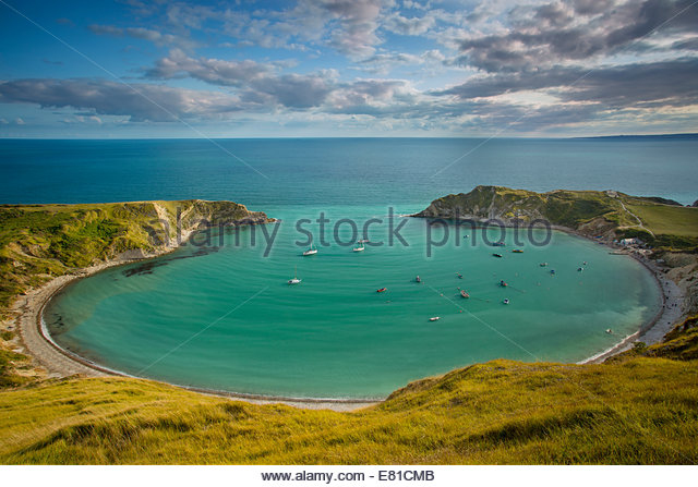 Evening view over Lulworth Cove along the Jurassic Coast, Dorset, England - Stock Image