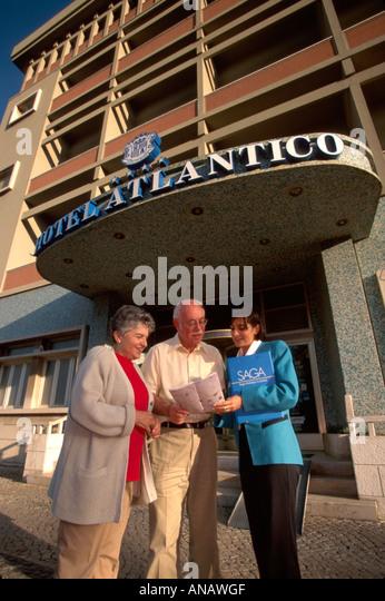 Portugal Monte Estoril Hotel Atlantico Saga Holidays tour guide senior couple brochure - Stock Image