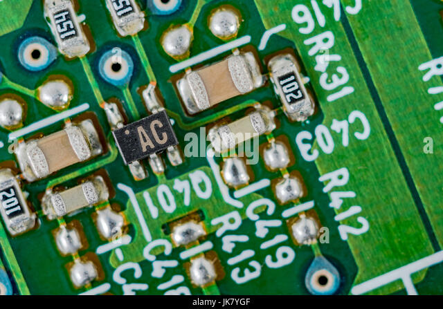 Surface mount technology (SMT) components on a green printed circuit board. - Stock Image