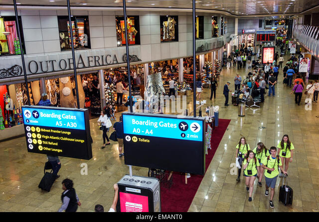 Johannesburg South Africa African O. R. Tambo International Airport terminal concourse gate area shopping business - Stock Image