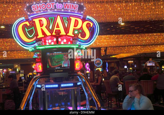 Nevada Las Vegas Las Vegas Hotel & Casino LVH slot machines machine gamblers gambling woman craps - Stock Image