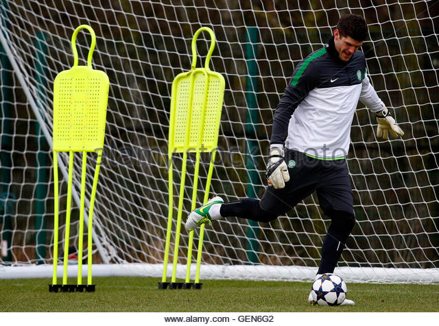 Celtic's goalkeeper Fraser Forster kicks a ball during a team training session, ahead of the Champions League - Stock Image
