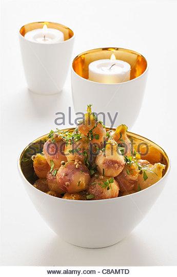 Small turnips glazed in honey and coriander - Stock Image