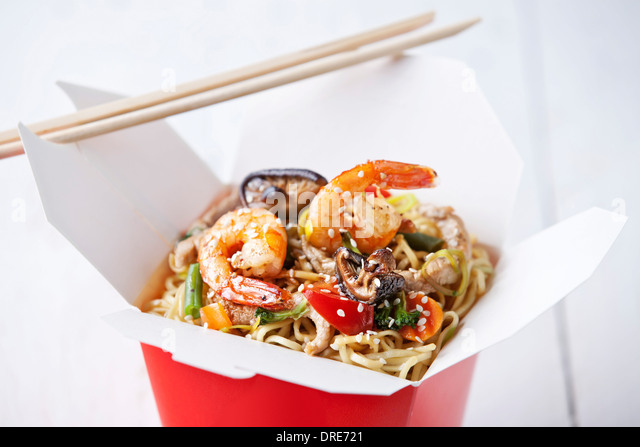 Egg noodles with shiitake mushrooms, shrimp and pork in sweet and sour sauce - Stock Image
