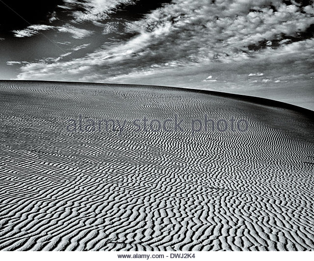 The rake light of the approaching dusk in the sand dunes of the ancient dead lake; Mungo Lake, New South Wales, - Stock Image