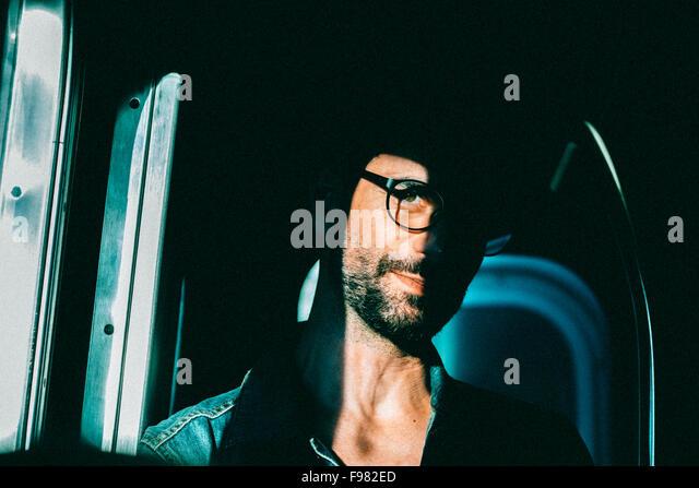 Portrait Of Young Man Wearing Eyeglasses - Stock-Bilder