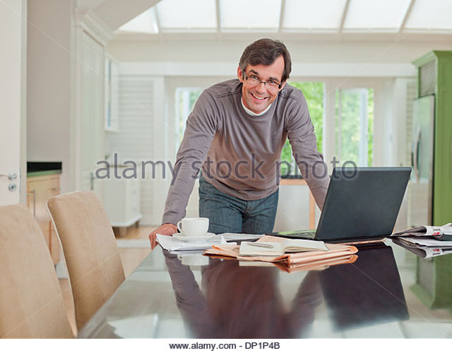 Man looking at laptop - Stock-Bilder