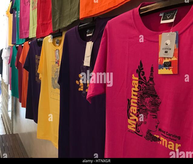 Rangun, Myanmar. 21st Feb, 2017. T-shirts made in fair production can be seen at a tourist market in Rangun, Myanmar, - Stock-Bilder