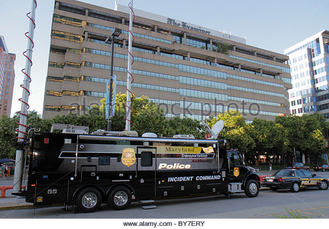 Maryland Baltimore 'Baltimore Examiner Building' police vehicle incident-command truck public safety emergency - Stock Image