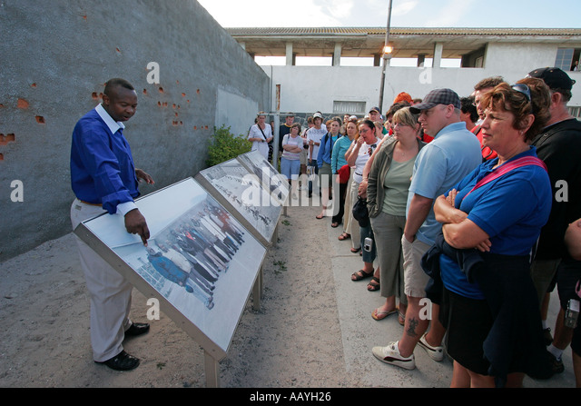 south africa Robben Island prison island of Nelson Mandela during apartheid former prisoner with tourists - Stock Image
