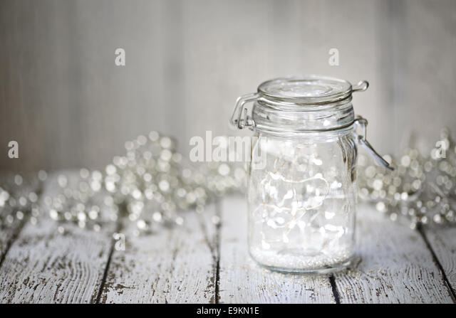 Fairy lights in a jar - Stock Image