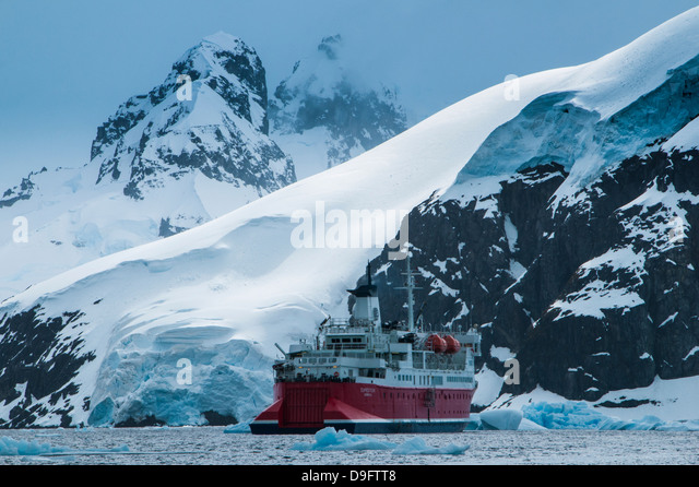 Cruise ship in front of the glaciers and icefields of Danco Island, Antarctica, Polar Regions - Stock-Bilder