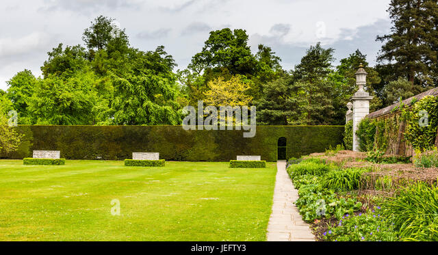 Three stone seats in the gardens at Cliveden, Buckinghamshire, UK - Stock Image