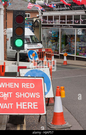 Temporary traffic lights in a small town - Stock Image