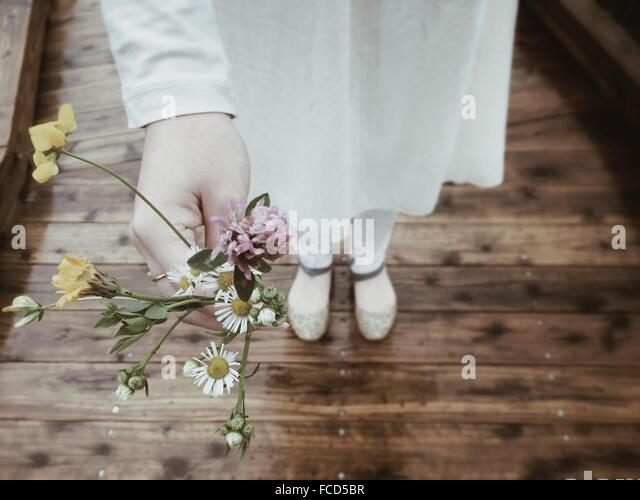 Close-Up Of Hand Holding Flowers - Stock Image