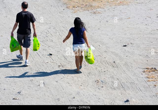 People walking over Sand in Angeles City, Luzon, Philippines - Stock-Bilder