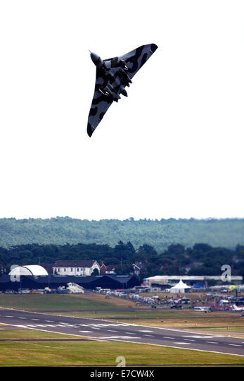 Avro 698 Vulcan B2  strategic bomber taking off at Farnborough International Airshow 2014 - Stock Image