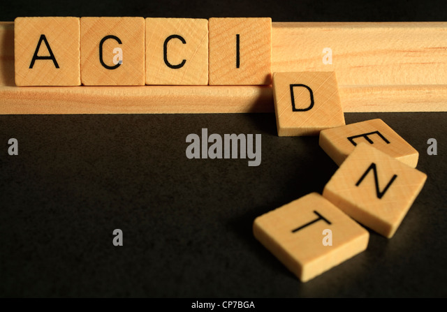 The word 'accident' spelled out in Scrabble alphabet letters, the letters DENT have fallen over - Stock Image