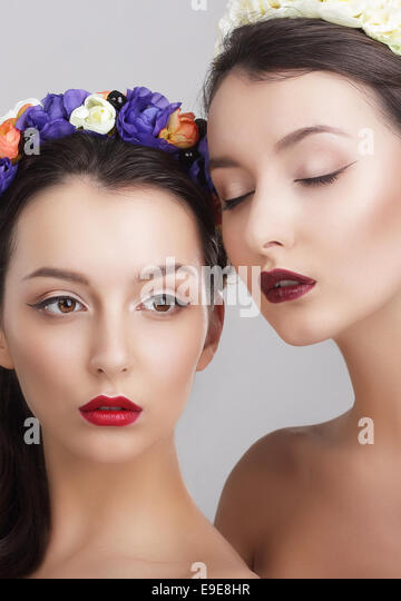 Imagination. Women in Garlands with Vernal Flowers - Stock Image