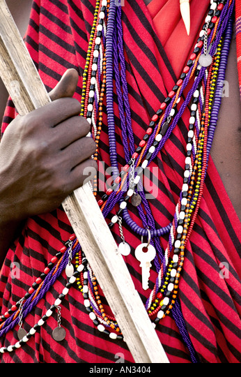 Kenya Close up of jewellery and weapons Maasai tribesman Masai Mara National Reserve - Stock Image
