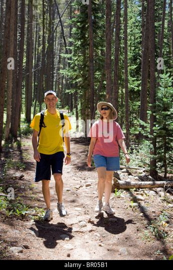 Middle aged woman and her son hiking on the trail along South Fooses Creek, Sawatch Range, Chaffee County, Colorado, - Stock Image
