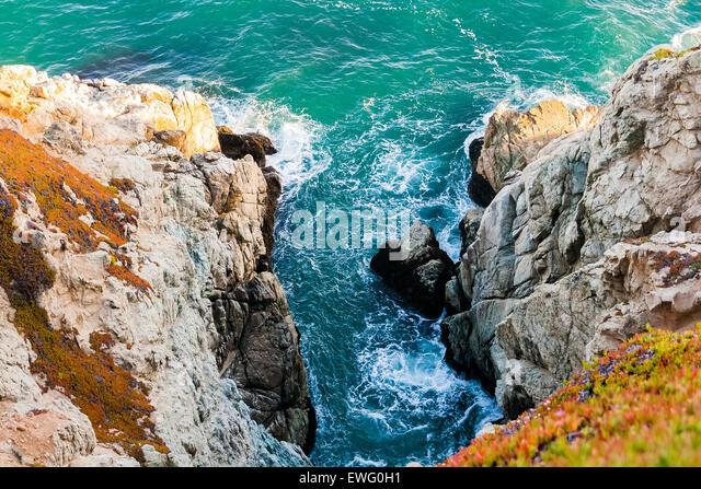 Ocean Inlet Between Rocky Outcrops - Stock Image