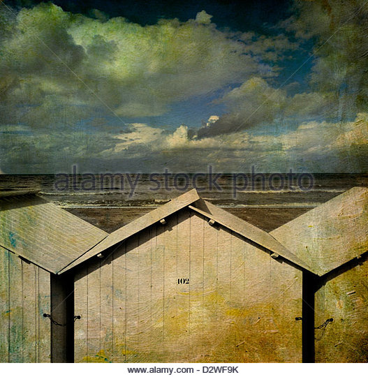 Beach huts under a stormy sky, vintage-look, Normandy, France, Europe - Stock Image