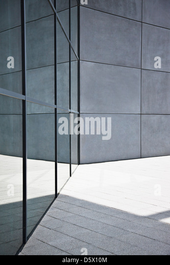 Glass and concrete walls of modern building - Stock Image