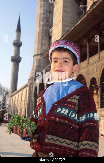 Turkey Istanbul Kurdish boy from Central Anatolia near Sulemaniye Mosque built 1557 - Stock Image