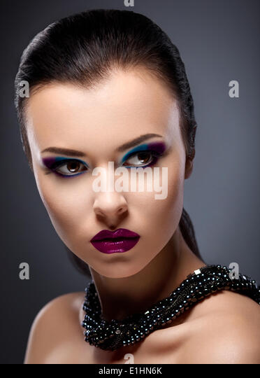 Strict Face of  Bright Honorable Brunette with Glossy Necklace - Stock Image