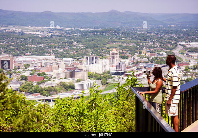 Virginia Roanoke Mill Mountain Overlook view downtown city valley Allegheny Mountains Blue Ridge Appalachian man - Stock Image